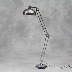 An extra large 'classic desk style chrome floor lamp. Superbly finished in polished chrome, the shade is fully adjustable, ideal for reading or relaxing. The size is ; x x inc delivery. Retro Floor Lamps, Silver Floor Lamp, Spotlight Floor Lamp, Anglepoise Lamp, Desk Styling, Traditional Floor Lamps, Adjustable Floor Lamp, Floor Standing Lamps