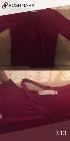 Long sleeve burgundy top This is a great top with the cutout shoulder. Ordered online and purchased two accidentally. Great top for jeans and boots. Tops Blouses
