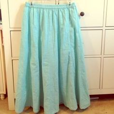 I just discovered this while shopping on Poshmark: Cathy Daniels Large Aquamarine Skirt. Check it out! Price: $15 Size: L
