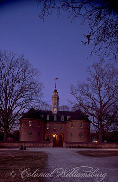 The Capitol at dusk with candles in windows for Christmas, Colonial Williamsburg