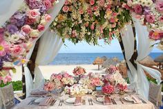 Unbelievable floral design by Karen Tran Floral at the beautiful beaches in the Riviera Maya at the Dreams Riviera Cancun hotel for a destination beach wedding ceremony. #Decor #design #floraldesign #epic