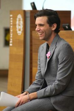Mika speaking at Bocconi University, Milan Dec 2013 I like it when he smiles like this! he looks so cute!