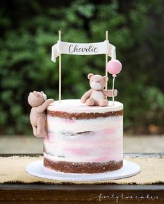 Cute little baby shower cake from the weekend Vanilla bean cake with dark chocolate Swiss meringue buttercream and a seminaked pink watercolour finish, decorated with handmade fondant teddy bears and name banner. Such fun to make!