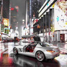 Built in Umbrella  Rain over Time Square with the SLS ------------------------------------------------- #Mercedes |#timesquare |#newyork |#iphone |#amg |#art |#wow |#cars |#new |#barnfind |#luxury |#carporn |#happy |#food |#instacar |#instagood |#love |#follow |#me |#model |#nyc |#selfie |#picoftheday |#photooftheday |#fashion |#porsche |#like |#love #igers #photography