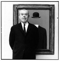 René Magritte in front of his painting The Pilgrim. photo by Lothar Wolleh