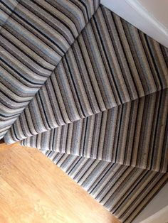 Striped carpet fitted on turned stairs fitted by Victoria Carpets.