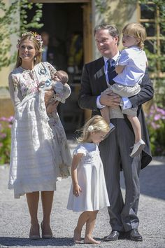 The proud couple pose for a photograph outside the chapel with a barefoot Princess Leonore...