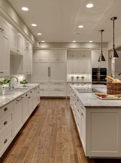 Maple floors, kashmir white granite countertops, darien pendant fixtures from lumens | Shuffle Interiors