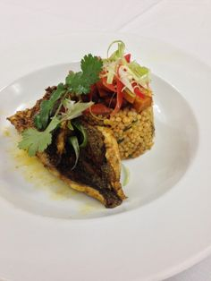 Sloppy plating of chermoula bream with Pumpkin couscous. (OC)