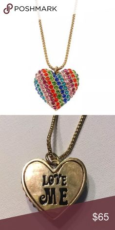 """NWT Betsey Johnson 60s Retro Rainbow ❤️ Necklace NWT Betsey Johnson Gold Rainbow With Rhinestone Love Me Heart Necklace  Retail Price: $85.00  FEATURES/DETAILS: •60s retro mod heart pendant necklace  •Featuring gold tone chain    •Gold tone heart pendant with rainbow multicolored crystals •Lobster claw closure  MATERIALS: •Antique gold plating.  •Metal •Glass material.   MEASUREMENTS: •16"""" length •3"""" adjustable links •1.4"""" pendant width •1.5"""" pendant drop length Betsey Johnson Jewelry…"""