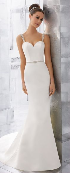 Simple and understated, this duchess satin wedding dress is accented with crystal beaded straps and illusion back detail.