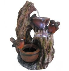 Bring a touch of the outdoors indoors with this birds and jars motif tabletop fountain. 2 birds in tree trunk table fountain. Style # at Lamps Plus. Indoor Tabletop Fountains, Backyard Water Fountains, Patio Fountain, Tabletop Water Fountain, Indoor Fountain, Garden Fountains, Indoor Waterfall Fountain, Small Water Fountain, Fountains For Sale