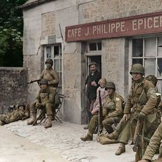 the_ww2_memoirs Infantrymen from the 90th Infantry Division stand outside the Café J.Phillipe.Epicerie after arriving in Sainte-Mère-Eglisé shortly after they arrived on the beaches of Normandy as reinforcements, June 7th, D-Day Plus 1, 1944. You can see the owner of the Café and his young daughter greeting the customers they have waited four years to receive. These soldiers were originally believed to be from the 4th Infantry Division but after closer examination on the original negatives…