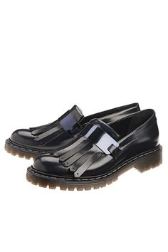 Fringe loafers with metal buckle. Rubber sole.