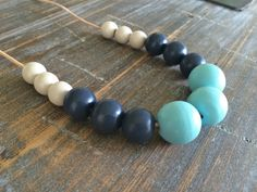 A classic style, only better! Hand painted geometric wooden bead necklace by ModFresh on Etsy, $27.00  www.ModFresh.etsy.com