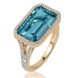 Goshwara Gossip Collection - Blue Topaz ring with diamonds in 18k gold - Blue Topaz 10 X 15mm, approximately 9.70 cts. total weight - Round brilliant white diamonds, approximately .76 cts. total weigh