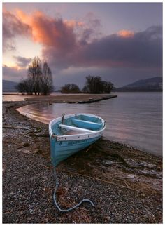 Blue boat on shore