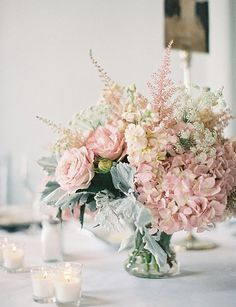 Faux Wedding Flowers: This vintage-style faux centerpiece offers classic elegance with its pink and blush faux flowers.