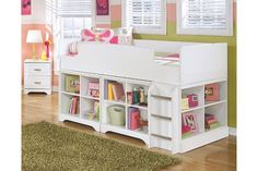 Lulu's clean lines and versatile white finish complement virtually every style of décor. Whether her new favorite color is pink, purple or blue, her bedroom furniture will be a mainstay. Six built-in drawers and a multi-compartment bookcase create much-needed storage. Mattress available, sold separately.