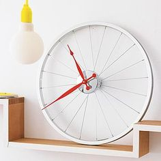 I've just found Bike Wheel Clock. A stylish and super cool bike wheel clock. A unique decoration at home, on the walls of an executive office or in a university halls.