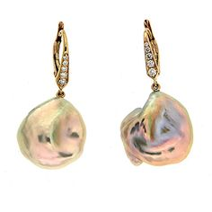 Baroque Fresh Water Pearl Earrings VME-409-White-18 These earrings are made in 18kt yellow gold with baroque fresh water pearl drops and round brilliant diamond set on the lever backs. Measurement detail - width 16.97 mm, length 35.17 mm, depth 8.4 mm.