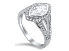 Timeless  Fine Jewelry has captured our heart with this marquis halo engagement ring.