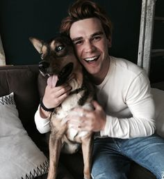 """Celebrities and their pets. Celebrity - """"Riverdale Star"""" with """"his dog"""". Cute photo of celebrity with their pet. Photography of dogs and their owners. Loving photos of owners and their pets. Dog photos. #celebrityanimalphotos"""