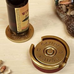 All tabletops need protection. Our shotgun shell coasters are sure to protect your coffee table at all times from watermarks and any harm that comes its way. Featuring a set of four coasters hand painted to resemble the ends of 12 gauge shotgun shells, ou