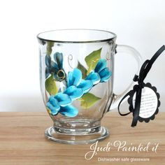 Cerulean blue wrap design glass mug that is hand painted by Judi Painted It. American Made. See the designer's work at the 2015 American Made Show, Washington DC. January 16-19, 2015. americanmadeshow.com #mug, #flower, #americanmade