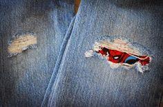 Cómo arreglar pantalones rotos