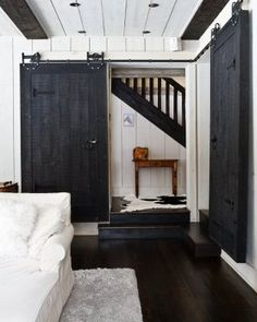 Installing interior barn door hardware can transform the look of your room. Read these steps in buying interior barn door hardware. Interior Sliding Barn Doors, Sliding Doors, Entry Doors, Patio Doors, Style At Home, Black Barn, Black White, White Barn, White Trim
