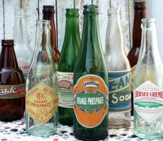 Make your own vintage-looking bottles by decoupaging printed vintage style labels onto bottles. Some free printables here!