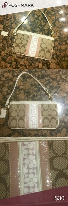 Coach Wristlet Like new condition. Detailing is a pale purple color which is best represented in the 3rd photo.  Inside has one small side pocket. Coach Bags Clutches & Wristlets