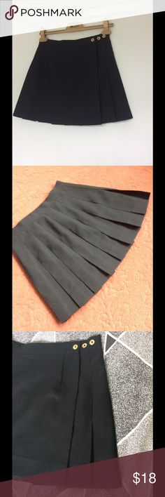 """Classic tennis pleat skirt SALE Never worn and such a cute classic this three button adjustable wrap around has a fully pleated back.. The largest waist adjustment is 26"""" the other two are one and two inches smaller. Length measures 15"""" Skirts Mini"""