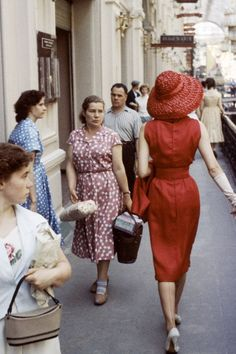 24 Classic Street Style Shots You've Never Seen Before #refinery29  http://www.refinery29.com/vintage-street-style-pictures#slide-14  Lady in red. Always head-turning.