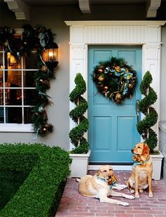Blue Door, White Molding, Wreath, Topiaries, Dogs! :) I love them all!!