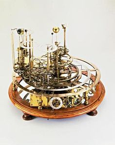 Clock and Planetary Model. Viewed from the top, this century device, designed by James Ferguson, is an amazingly complex clock. Viewed from the side, its role as a planetary model becomes apparent. Planetary Model, Alter Computer, Solar System Model, Mechanical Art, Instruments, Model Gallery, Gallery Gallery, Antique Clocks, Messing