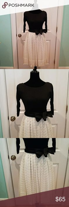 """VINTAGE 50-60'S BLACK & CREAM  LACE DRESS Such a pretty piece of history, love this dress. Fitted black bodice with gathered 3/4 length sleeves, full lace skirt, zips up the back. Needs a dry cleaning and some fraying of fabric on the interior. The bust is 34"""", waist is 25""""and the length is 41"""". Vintage Dresses"""