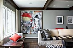 """Rule #1: Hang Artwork Symmetrically in a Room """"I like to place art to create the effect I am looking for rather than in an expected location, like centered over the couch. Sometimes I like to take artwork off grid because I think symmetry can be stultifying and stiff. In the living room above, the large painting was placed to the far left of the sofa to serve as afocal point from thehallway that leads straight to the room."""" Elizabeth Vallino, ofElizabeth Vallino Interiors"""
