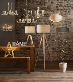 Go rustic with lighting this season with these wooden tripod lights and antler pendants.