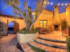 Exterior, Mediterranean Home Design Have Classic Patio With Ancient Fireplace Also Wooden Bench And Table That Designed In Antique Looks: Pr...