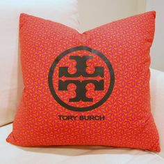 Upcycled Tory Burch Pillow by 5thstreetbazaar on Etsy, $79.00    Good idea.. Time to convert my dust bags!