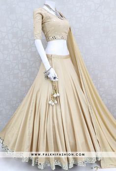 14 Meter Flair Bold & Beautiful Beige Mirror Work Chaniya Choli Set Palkhi fashion exclusive beige premium cotton satin silk navratri chaniya choli & blouse with real mirror work.It comes with pure chiffon dupatta. Party Wear Indian Dresses, Designer Party Wear Dresses, Indian Gowns Dresses, Indian Bridal Outfits, Dress Indian Style, Indian Fashion Dresses, Indian Designer Outfits, Choli Blouse Design, Choli Designs