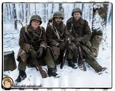 """""""Slightly wounded 26th Division Infantrymen await evacuation from forward area near Wiltz, Luxembourg, half their Company was wiped out during bitter fighting. Left to right: TEC/5 Harrison Miller, PFC A.E. Cavolio ,and PFC Claude Gapland. Company I, 328th Infantry Regiment January 27, 1945"""" Coloured by historic Photo restored in color"""
