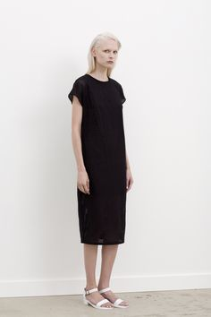 #GARYBIGENI STEN - Capped sleeve, double layered perforated laser cut dress. Available in black only / Fabric: 100% Italian Cotton. For more information on stockists & availability, please visit: garybigeni.com