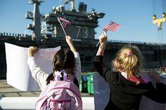 Family members of Sailors on Nimitz-class aircraft carrier USS George Washington (CVN-73) gather to greet the ship. #americasnavy #usnavy navy.com