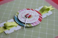 Make a simple embellishment by layering a small strip of paper, ribbon, 2 circles, a button and thread. Use 3D adhesive to give it dimension. Perfect for those pages that need a little something extra. . . just in time!  :) . . .