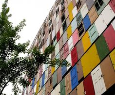 South Korean installation artist Choi Jeong-Hwa takes a break from his preferred medium of plastic to completely cover the facade of an anonymous  10-story building in Seoul with 1,000 repurposed doors