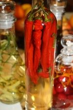 Hot Chili Pepper in White Wine Vinegar is for those who really like to spice things up.  Get this and other flavored or infused vinegar recipes http://www.gettystewart.com/gifts-from-the-kitchen-infused-vinegar/