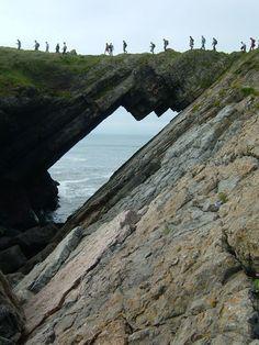 Crossing Devil's Bridge on Worm's Head, Gower, Wales © National Trust